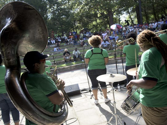 Members of the Original Pinettes Brass band perform