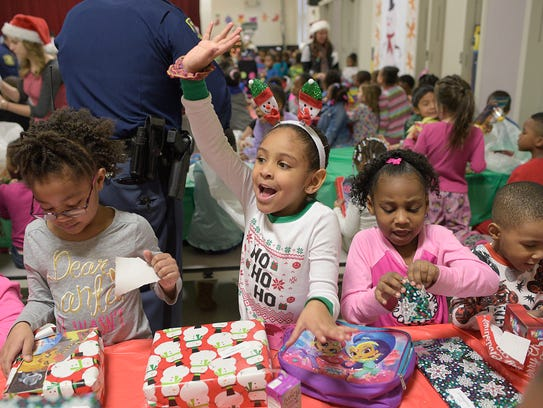 Brielle Ballard, 5, is excited to open her presents.