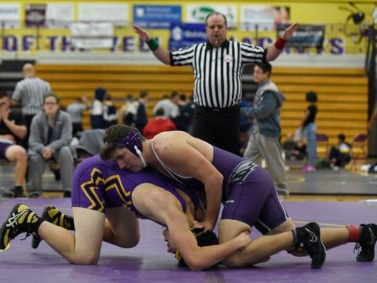 Bloomfield Hills' Andrew Faber wrestles Avondale's