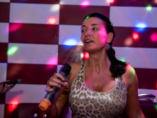Anisa Trela sings karaoke in one of 10 private karaoke