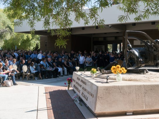 Hundreds attend a ceremony to add the names of Officers