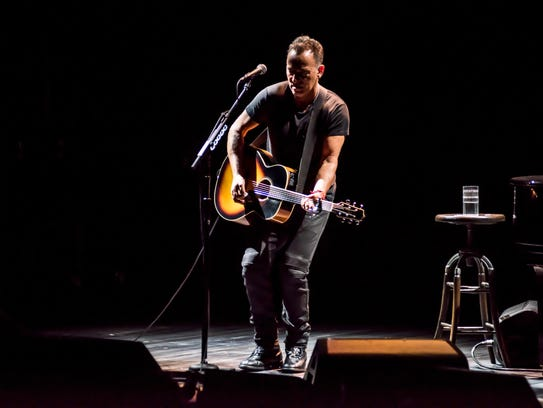 """Bruce Springsteen performs in """"Springsteen on Broadway"""" at the Walter Kerr Theatre. Courtesy of Rob DeMartin"""