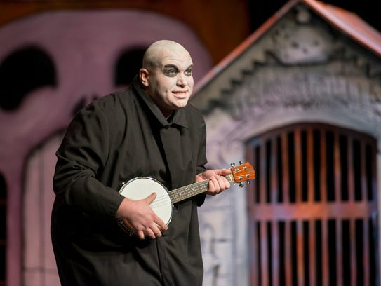 Justin Jones as Fester performs during rehearsal of