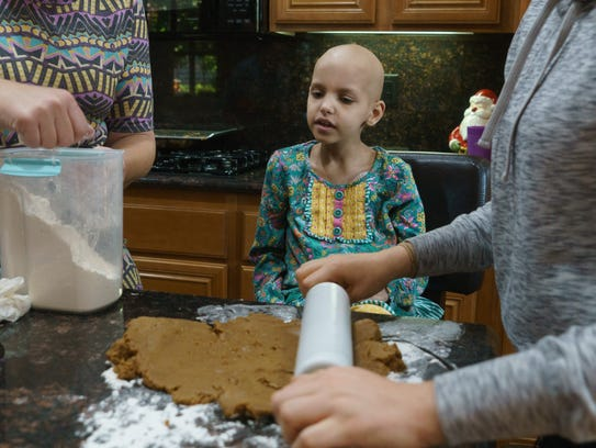Riley Rose Sherman makes cookies with her mother and