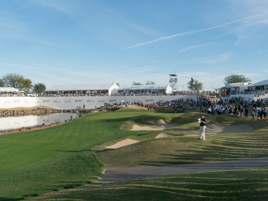 Spectators fill the area surrounding the 18th hole