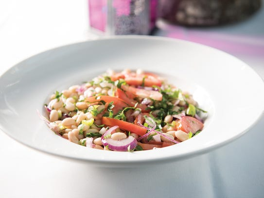 Piyaz Salad, made with white beans, tomatoes, red onion,