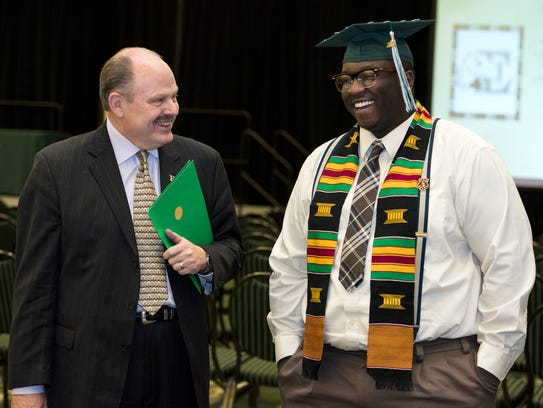Eastern Michigan University President James Smith with