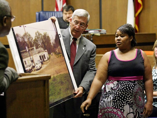 Clemmie Flemming points out to prosecutor Doug Evans, center, where she spotted Curtis Giovanni Flowers on the morning of four slayings at Tardy Furniture in Winona on July 16, 1996, onJune 14, 2010 in Greenwood, Miss. This was the sixth time Flowers, then 40, was tried for the slayings.