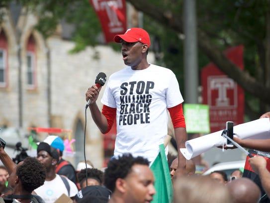 Asa Khalif speaks to the crowd at a Black Lives Matter