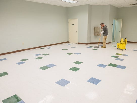 Edward Cardwell of Equity Restore waxes a floor in