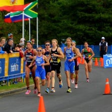 Avery Evenson of Hartland (left) runs with the leaders in the ITU Junior World Championships in Edmonton, Alberta on Friday.