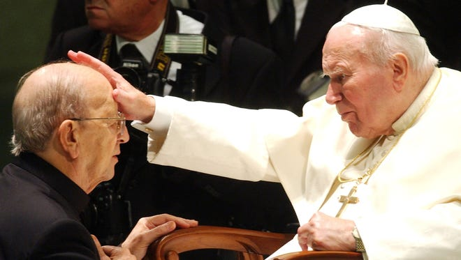 Pope John Paul II gives his blessing to father Marcial Maciel, founder of Christ's Legionaries, during a special audience the pontiff granted to about four thousand participants of the Regnum Christi movement, at the Vatican.