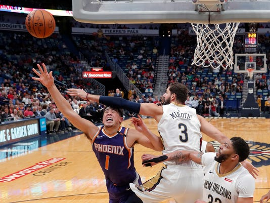 Phoenix Suns guard Devin Booker (1) goes to the basket against New Orleans Pelicans forward Nikola Mirotic (3) in the first half of an NBA basketball game in New Orleans, Monday, Feb. 26, 2018. (AP Photo/Gerald Herbert)