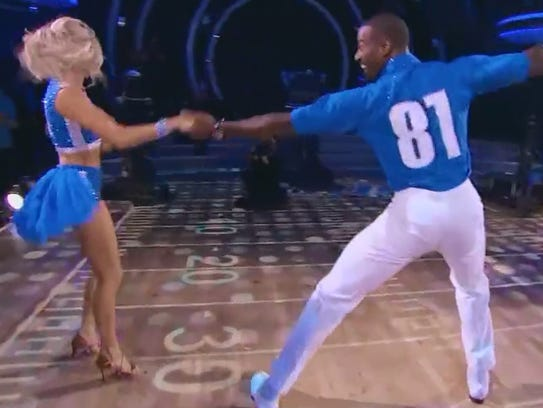 Ex-Lion Calvin Johnson cha-chas with Lindsay Arnold
