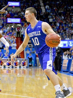 UNC Asheville guard Kevin Vannatta (10) dribbles the ball during the game against the Kansas Jayhawks at Allen Fieldhouse.