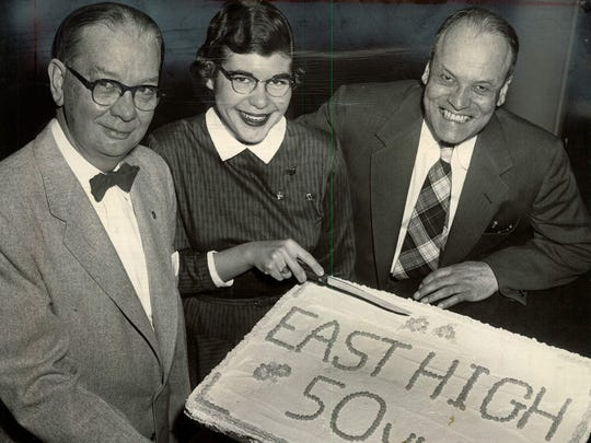 Celebrating East High School's 50th anniversary are, from left, Board of Education president John E. Keenan, Gail Gallinger and principal William Wolgast.