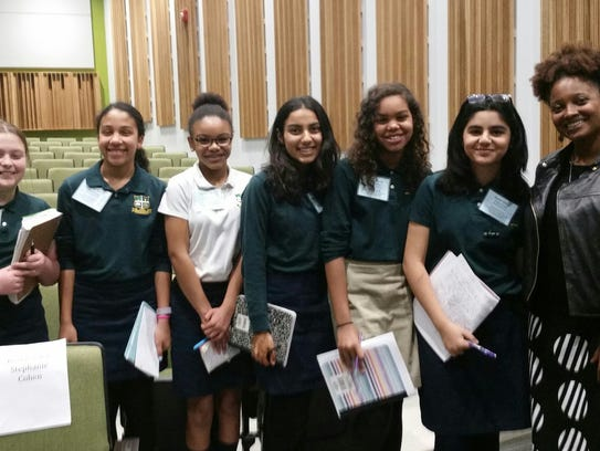 Middle School students Vanessa Fang of Edison, Jasmine Burney of Plainfield, Nelagh Matthews of Metuchen, Rose Kassam of Scotch Plains, Samia Silver of Rahway and Simrah Razvi of Somerset pose for a photo with Tracy K. Smith after her poetry reading