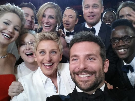 Oscars host Ellen DeGeneres poses for a selfie taken