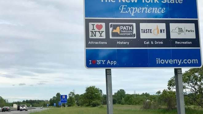 "Gov. Andrew Cuomo's administration and the Federal Highway Administration have been battling over the large, blue ""I Love NY"" highway signs that are in groups of five and dot the state's roadways, including here on I-90 East in Rotterdam, Schenectady County."