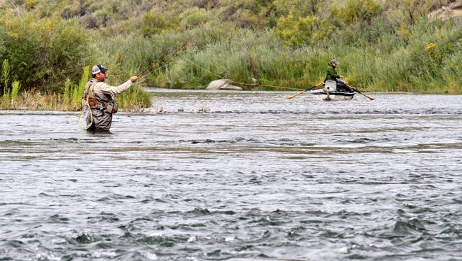 Anglers fly-fish on Sept. 4 at the Quality Waters of the San Juan River near Navajo Dam.