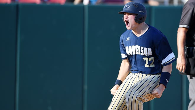 Ty Gossett celebrates after scoring Roberson's final run in Friday's 3-1 win over New Hanover at N.C. State.
