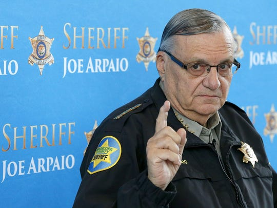 In this Dec. 18, 2013 photo, then-Maricopa County Sheriff Joe Arpaio pauses as he answers a question at a news conference at Maricopa County Sheriff's Office Headquarters in Phoenix.