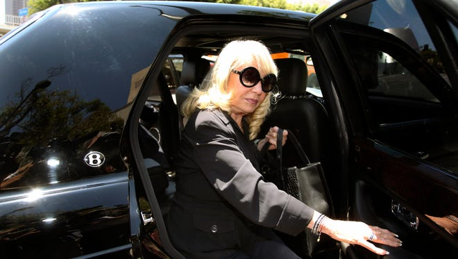 Shelly Sterling, the extranged wife of Los Angeles Clippers owner Donald Sterling, arrives at a Los Angeles courthouse Tuesday for the second day of the probate trial over the $2 billion cl;ub's sale to former Microsoft CEO Steve Ballmer.