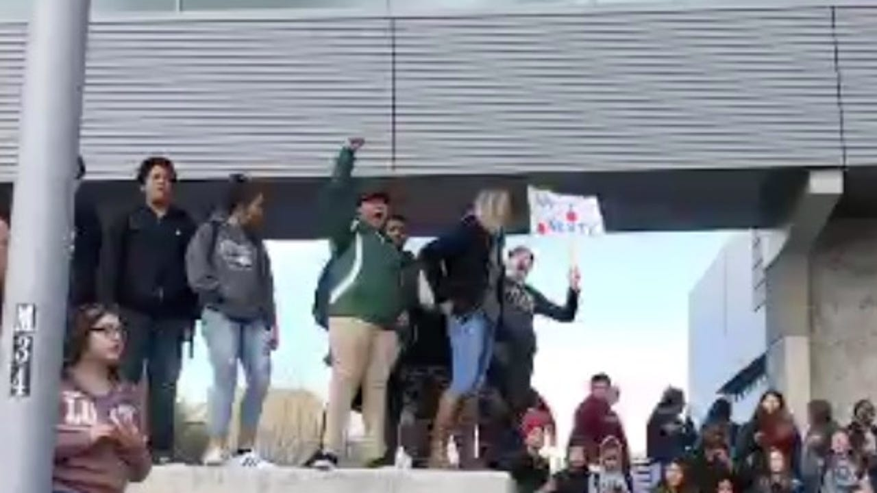 Scores of Hug High School students marched to the University of Nevada, Reno campus on Wednesday.