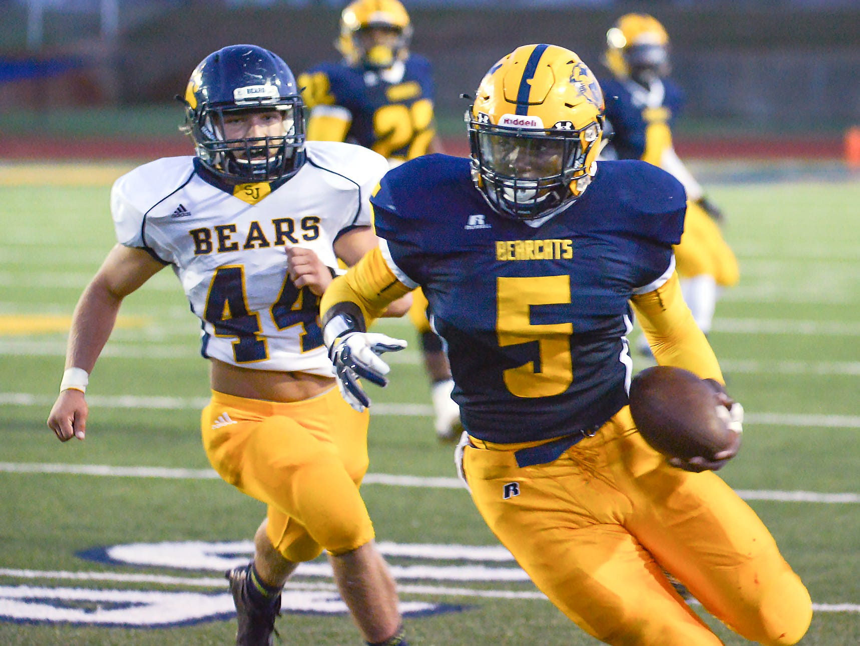 Central's RB Brandon Randle catches a pass and rushes for positive yards Friday night as Battle Creek faces St. Joseph Bears.
