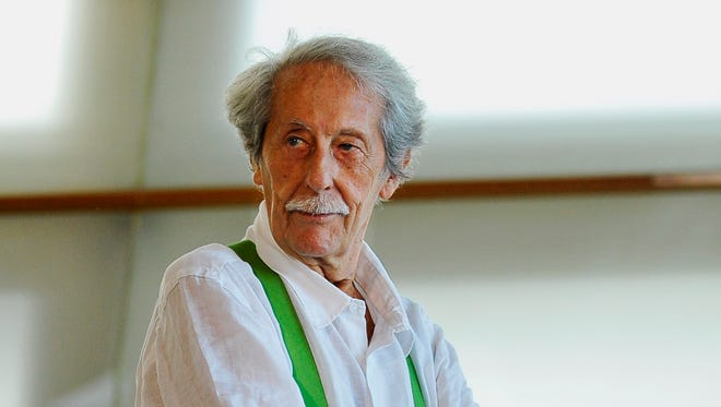 """In this Sept.24, 2012 photo, Jean Rochefort, poses during the photo call to promote his film '' The Artist and The Model"""" in San Sebastian, Spain."""