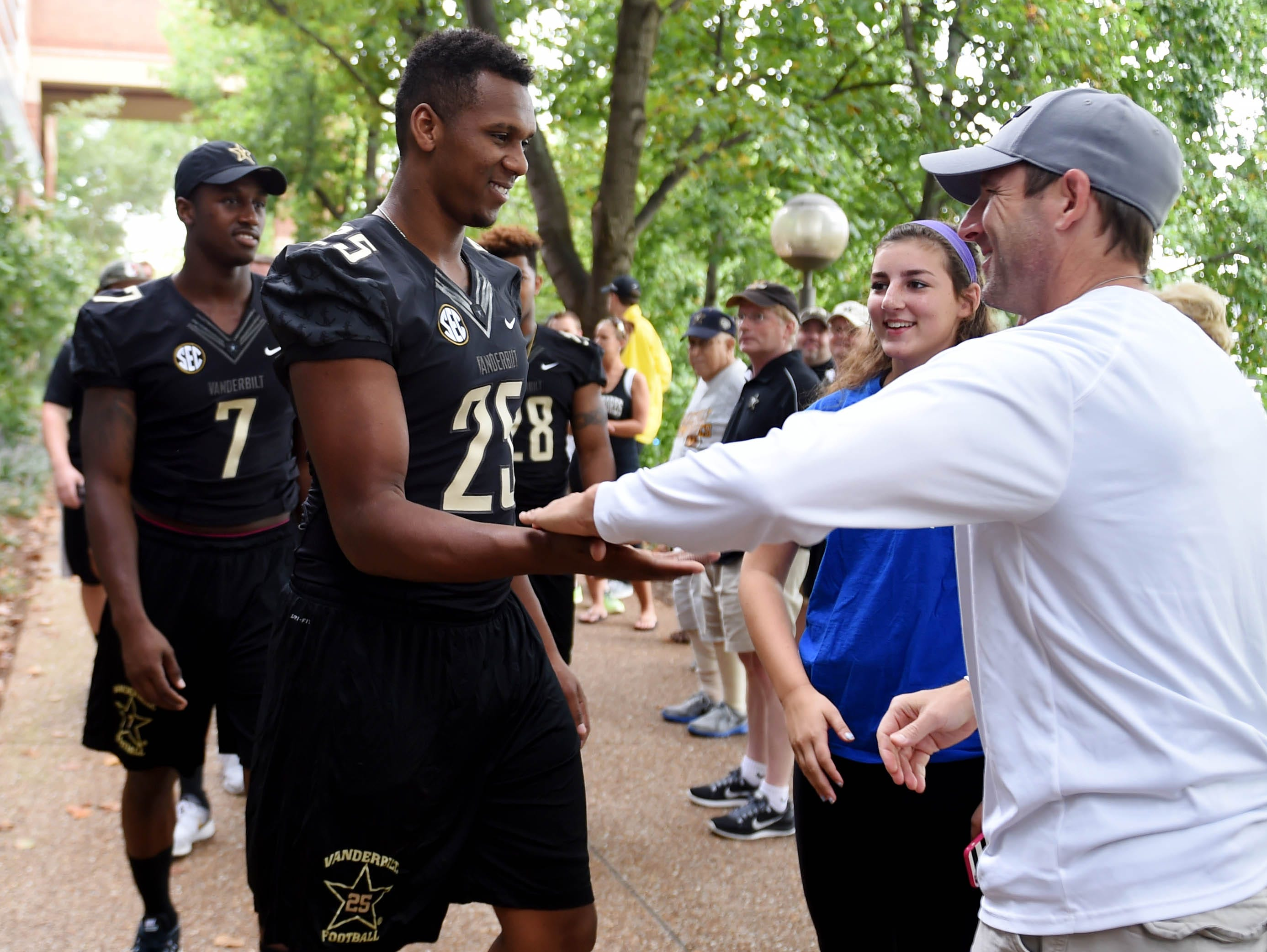 Vanderbilt football players and brothers Emmanuel and Josh Smith are greeted by Steve Rector during Vanderbilt's annual Dore Jam fan event on Sunday Aug. 16, 2015. Rector's son Andrew plays football for Vanderbilt.