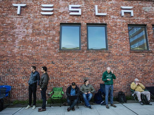 People wait in line to pre-order the new Tesla last month in Seattle.