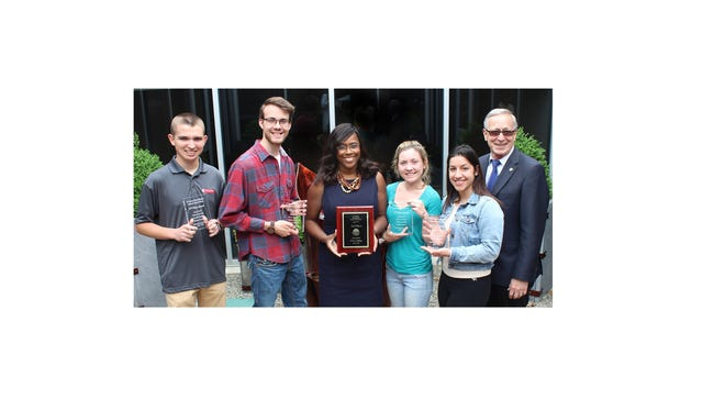 (From left) Jared Carll and Bob Novicke, criminal justice students at Cumberland County College; Yves Salomon-Fernandez, college president; Kelsey Grisack and Giselle Badillo, criminal justice students; and Charles Kocher, professor of Criminal Justice & Public Administration Studies, celebrate the students' second place finish at the fourth annual regional Criminal Justice Debate. Salomon-Fernandez holds the second place plaque while the students display their second place awards.