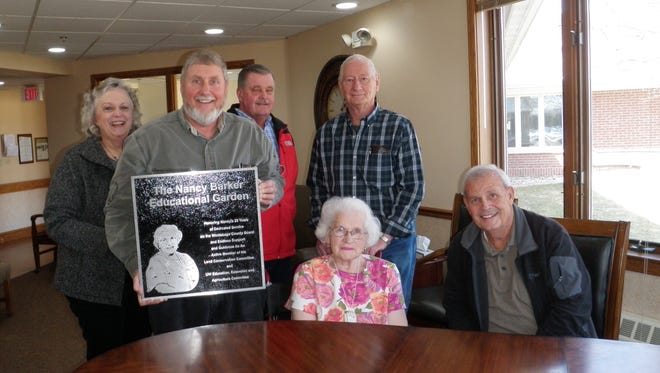 Nancy Barker was recently honored for 25 years of service to Winnebago County. Pictured are first row, from left, Tom Davies, Barker, Jerry Finch; second row, Chris Kniep, Steve Binder and Chuck Farry.