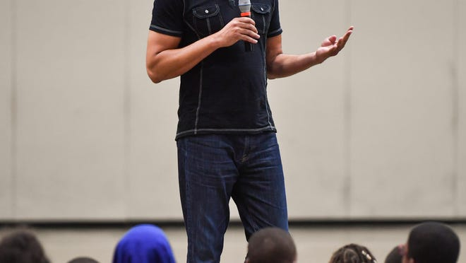 David Booth addresses basketball campers at the J.J. Anderson Basketball Camp in Peoria in a recent summer.