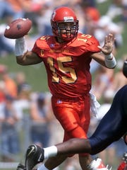 Iowa State quarterback Seneca Wallace looks to pass against Kansas during their game in 2002.
