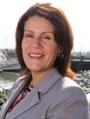 Perth Amboy Mayor Wilda Diaz supports the high school baseball team