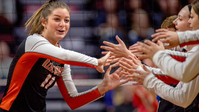 Illini Bluffs' Peyton Pollman slaps hands with her teammates during player introductions before their Class 1A volleyball state semifinal against Norris City-Omaha-Enfield on Friday, Nov. 15, 2019 at Redbird Arena in Normal. Illini Bluffs won in straight sets 25-19, 25-22 to advance to Saturday's title game.
