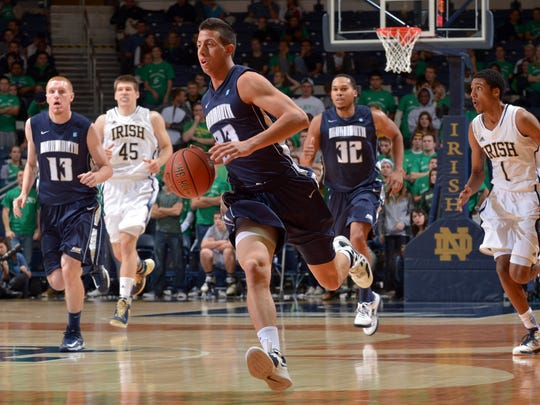 Monmouth's Stephen Spinella (23) dribbles up the court in the first half against Notre Dame in 2012.