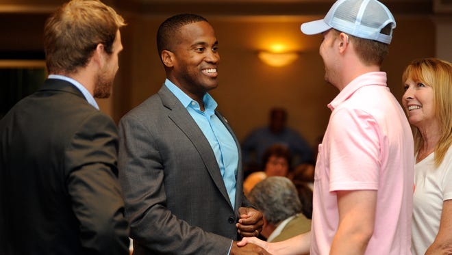 "Republican U.S. Senate candidate John James, center, a businessman from Farmington Hills, greets supporters during the ""Macomb for John James"" event held at Villa Penna banquet hall in Sterling Heights, Mich., Monday, July 16, 2018."