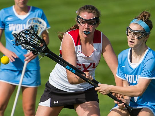 Champlain Valley Union's Teddi Simons, left, and South Burlington's Dakota Crane go after the ball in Hinesburg on Wednesday, May 16, 2018.
