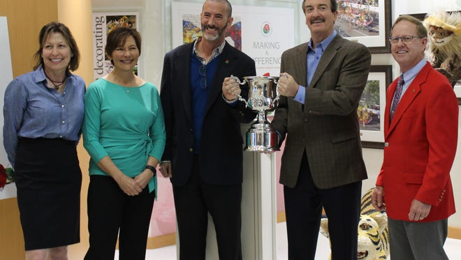 Dole Packaged Foods accepts the 2017 Tournament of Roses Parade sweepstakes trophy from Lance Tibbet, president of the Pasadena Tournament of Roses. From left are Barbara Vass, senior director of marketing for Dole Packaged Foods; Monica Spiro, associate manager of events for the company; David Spare, vice president of marketing and acquisitions; Brad Bartlett, president; and Tibbet.