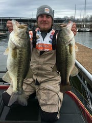 Scott Ellis of Madison shows off the 5.5- and 5.8-pound largemouth bass he caught during the Cabela's Collegiate Big Bass Bash on Kentucky Lake in this file photo. The lake was recently stocked with more than 300,000 largemouths.