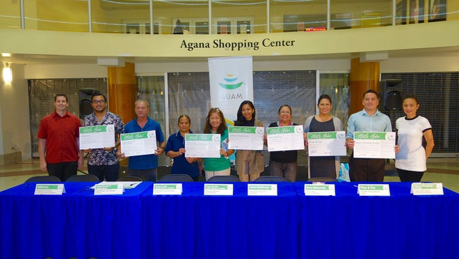 The Guam Visitors Bureau welcomed the newest HŒfa Adai Pledge members to the program — Tango Inc. dba Agana Stadium Theaters, Jean's Warehouse, New Memories, the Department of Agriculture and HDR Inc. — on Sept. 13. Agana Shopping Center and Fizz & Co. also joined the ceremony to renew their pledges. From left: Nicholas Manley, HDR Inc. project manager; Raphael Chavez, HDR Inc. architectural project coordinator; Matthew L.G. Sablan, director, Guam Department of Agriculture; Marylou Mejares, Tango Inc. dba Agana Stadium Theaters, operations manager; Jeannette Leon Guerrero, Tango Inc. senior staff; Mary Jane Gutierrez, Jean's Warehouse store manager; Mary Cruz, New Memories vice president, sales and marketing; LeAnn Crisostomo, Fizz & Co. owner; Charles McJohn II, Agana Shopping Center marketing manager; and Ana Cid, Guam Visitors Bureau director of tourism research.