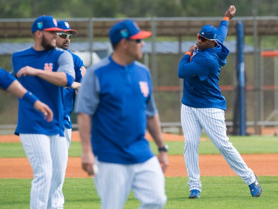 New York Mets outfielder Yoenis Cespedes (right) stretches with teammates Monday, Feb. 19, 2018, at the first full-squad spring training workout at First Data Field in Port St. Lucie. Unable to play a full season last year because of hamstring issues, Cespedes has taken up yoga to help with flexibility.
