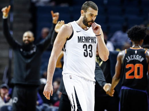 Memphis Grizzlies center Marc Gasol (middle) walks