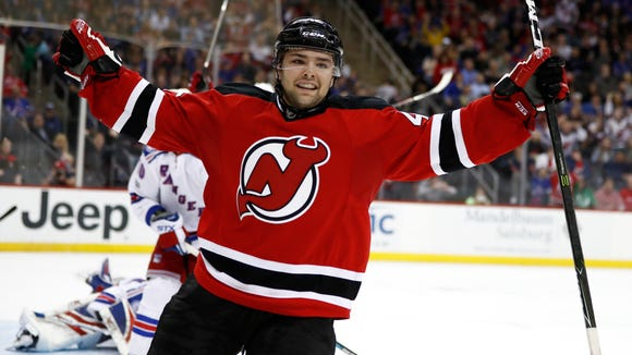 Devils center John Quenneville celebrates after scoring his first NHL goal during the second period of Tuesday night's game against the Rangers.