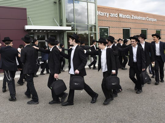 "Lubavitch Yeshiva-International School for Chabad Leadership students perform a Hasidic dance at the Oak Park campus to finalize the ""Detroit Tefillin Challenge 1,500."" The rabbis-in-training spent weeks aiming to perform the Hebrew ritual with 1,500 people across the region."