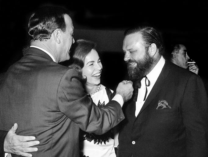 Eddy Arnold, left, Jo Walker of CMA and trumpeter Al