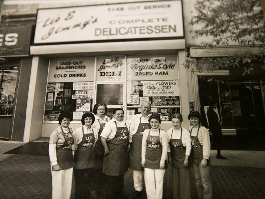 An old photo of Barbara Hackett (second from left), with her late husband, Jimmy, owners of Leo & JimmyÕs Delicatessen on Market Street in downtown Wilmington will close it's doors May 5th after being in business for 87 years.